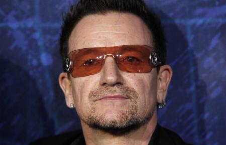 Bono of U2 arrives at the Broadway opening of ''Spider-Man: Turn Off The Dark'' in New York June 14, 2011. Bono on Sunday denied reports he had been taken to hospital after complaining of chest pains while on holiday in the south of France. REUTERS/Jessica Rinaldi/Files