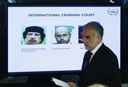 International Criminal Court's (ICC) chief prosecutor Luis Moreno-Ocampo arrives at a news conference to comment on the arrest warrant issued for Libyan leader Muammar Gaddafi in The Hague June 28, 2011. REUTERS/Jerry Lampen