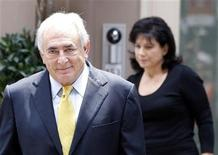 Former International Monetary Fund (IMF) chief Dominique Strauss-Kahn and his wife Anne Sinclair leave their temporary Manhattan residence in New York July 6, 2011.REUTERS/Shannon Stapleton