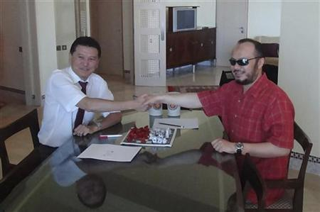 Mohammed Gaddafi (R), eldest son of Libyan leader Muammar Gaddafi, shakes hands with visiting head of the World Chess Federation Kirsan Ilyumzhinov during their meeting in Tripoli June 12, 2011. REUTERS/FIDE Press service/Handout