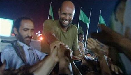 Saif Al-Islam, son of Libyan leader Muammar Gaddafi, shakes hands with supporters in Tripoli August 23, 2011 in this still image taken from video. REUTERS/Reuters TV