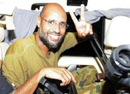 Saif al-Islam, the son of Libyan leader Muammar Gaddafi, gestures as he talks to reporters in Tripoli August 23, 2011. REUTERS/Paul Hackett
