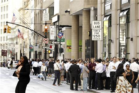 Office workers evacuated from buildings on Broadway in New York stand outside after a magnitude 5.9 earthquake that struck the US East Coast August 23, 2011. REUTERS/Lucas Jackson