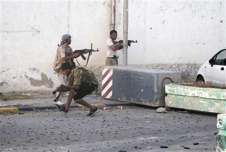 Libyan rebels fight at Bab Al-Aziziya compound in Tripoli, August 23, 2011. REUTERS/Louafi Larbi