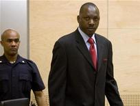 Congolese militia leader Thomas Lubanga (R) enters court at the beginning of his trial at the International Criminal Court (ICC) in The Hague January 26, 2009. REUTERS/ICC/Handout