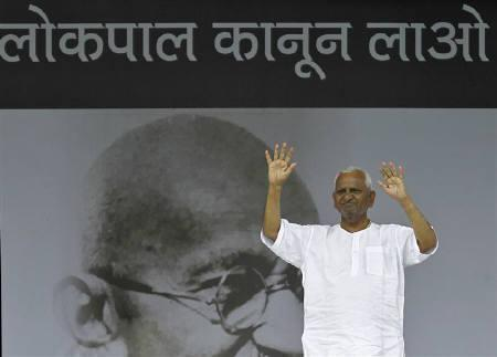 Social activist Anna Hazare greets his supporters on the ninth day of his fasting at Ramlila grounds in New Delhi August 24, 2011. The letters read, ''Bring the Lokpal legislation''. REUTERS/Adnan Abidi