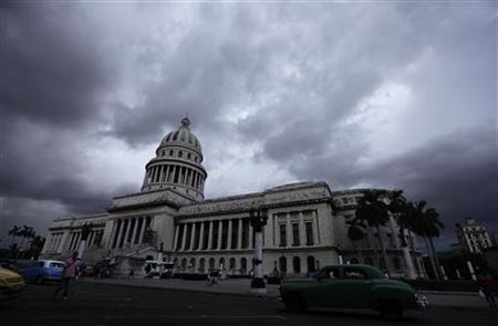 Storm clouds gather in the sky over Havana's City Capitol building August 18, 2011. REUTERS/Desmond Boylan
