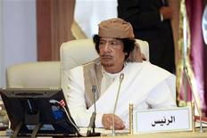 Libya's leader Muammar Gaddafi attends a meeting involving five Arab states in Tripoli June 28, 2010.   REUTERS/Ismail Zitouny