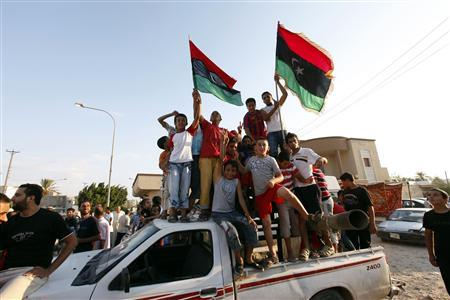 Children celebrate the fall of Tripoli, in Janzour, August 23, 2011. REUTERS/Ismail Zitouny