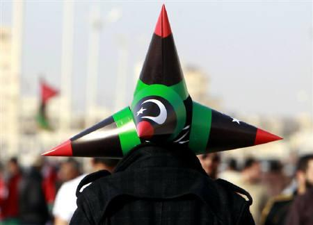 A Libyan man wears 4 hats in the design of the Kingdom of Libya flag, at Court Square in Benghazi April 24, 2011. REUTERS/Amr Abdallah Dalsh