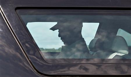 President Obama leaves his compound on his way to play golf on Martha's Vineyard in Massachusetts, August 24, 2011. REUTERS/Kevin Lamarque
