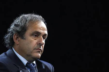 UEFA president Michel Platini awaits the start of the 61st FIFA congress at the Hallenstadion in Zurich June 1, 2011. REUTERS/Christian Hartmann/Files