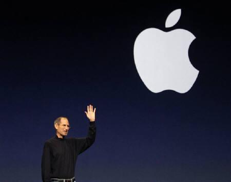 Apple Inc. CEO Steve Jobs gives a wave at the conclusion of the launch of the iPad 2 on stage during an Apple event in San Francisco, California March 2, 2011. REUTERS/Beck Diefenbach