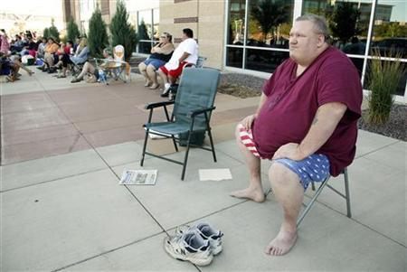 Clifford Clark, weighing 485 pounds waits in line for an open casting call for season 11 of ''The Biggest Loser'' television show in Broomfield, Colorado July 17, 2010. REUTERS/Rick Wilking