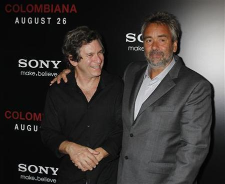 Writer Robert Kamen (L) and writer and producer Luc Besson arrive at a special screening of their new film ''Colombiana'' in Los Angeles, California August 24, 2011. REUTERS/Fred Prouser