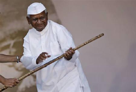 Veteran Indian social activist Anna Hazare holds a baton on the 12th day of his fast at Ramlila grounds in New Delhi August 27, 2011. REUTERS/Parivartan Sharma