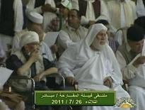 Abdel Baset al-Megrahi (L), who was convicted for the 1988 Lockerbie bombing over Scotland, sits in a wheelchair as he attends a pro-government rally in Tripoli in this still image from a July 26, 2011 video from Libyan state television.