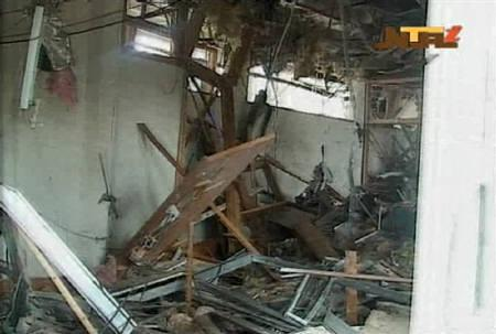 Damage is seen in a room after a bomb blast at the United Nations offices in the Nigerian capital of Abuja August 26, 2011. The blast happened after a car rammed into the building, and witnesses said they had seen a number of dead bodies being carried from the site. REUTERS/NTA via Reuters TV