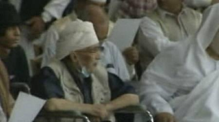 Abdel Baset al-Megrahi, who was convicted for the 1988 Lockerbie bombing over Scotland, sits in a wheelchair as he attends a pro-government rally in Tripoli in this still image from a July 26, 2011 video from Libyan state television.  REUTERS/Reuters TV via Al Jamahirya/Files