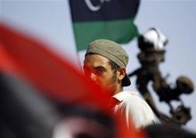 <p>A rebel fighter drives his vehicle as he patrols with other rebels in the town of Abu Grein, some 128 km (80 miles) west of Sirte, Muammar Gaddafi's last remaining stronghold, August 29, 2011. REUTERS/Goran Tomasevic</p>