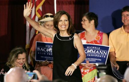 Republican U.S. presidential candidate Michele Bachmann waves during a rally in Florence, South Carolina August 18, 2011. REUTERS/Mary Ann Chastain