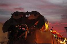 "<p>""Abraxas,"" a 60 foot long, 30 foot high dragon built atop a bus and created for the Burning Man Festival in Nevada, is seen at sunset after the ""Rally to Restore Sanity and/or Fear"" in Washington, October 30, 2010. REUTERS/Jim Bourg</p>"