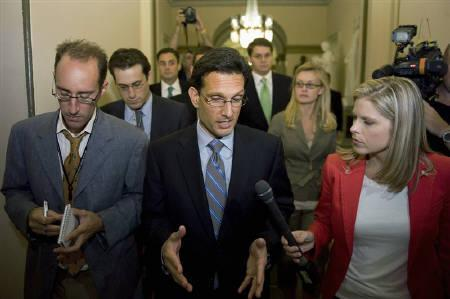 U.S. House Majority Leader Eric Cantor (R-VA) (C) talks to reporters as he walks from the House chamber after voting on debt ceiling legislation at the U.S. Capitol in Washington, August 1, 2011. REUTERS/Jonathan Ernst