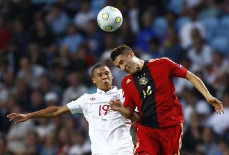 Fabian Johnson (R) heads the ball during a soccer match at Malmo New Stadium in Malmo June 29, 2009. ohnson will not be able to make his debut for the United States in September friendlies against Costa Rica and Belgium as he has yet to receive clearance from FIFA. REUTERS/Christian Charisius/Files