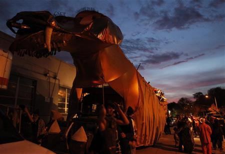 ''Abraxas,'' a 60 foot long, 30 foot high dragon built atop a bus, created for the Burning Man festival in Nevada, is seen at sunset after attending the ''Rally to Restore Sanity and/or Fear'' in Washington, October 30, 2010. REUTERS/Jim Bourg