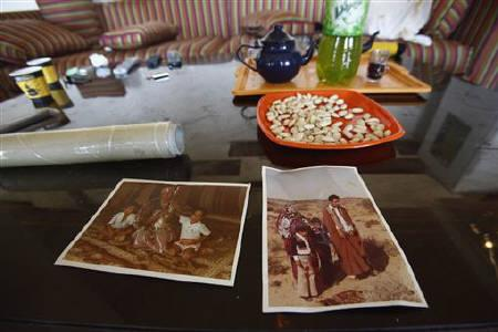 Pictures of Muammar Gaddafi and his family are seen at his beach house in Tripoli August 28, 2011. REUTERS/Zohra Bensemra