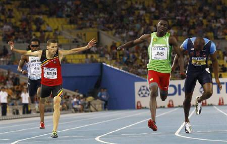 Kirani James of Grenada (2nd R) crosses the finish line to win ahead of LaShawn Merritt of the U.S. (R) and Kevin Borlee of Belgium during the men's 400 metres final at the IAAF World Championships in Daegu August 30, 2011.   REUTERS/Michael Dalder