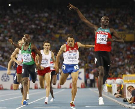 David Lekuta Rudisha (R) of Kenya reacts after crossing the finish line to win the men's 800 metres final at the IAAF World Championships in Daegu August 30, 2011. REUTERS/Michael Dalder