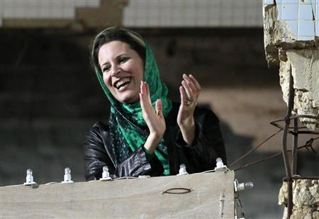 Aisha Gaddafi, daughter of Libya's leader Muammar Gaddafi, claps during a pro-government rally at the heavily fortified Bab al-Aziziya compound in Tripoli, April 14, 2011. REUTERS/Louafi Larbi