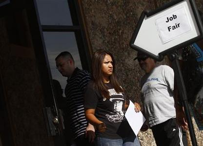 A woman exits a job fair at the Phoenix Workforce Connection as others wait to enter in Phoenix, Arizona August 30, 2011. REUTERS/Joshua Lott