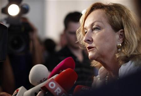 Austrian Finance Minister Maria Fekter briefs the media as she arrives for the weekly cabinet meeting (Ministerrat) in Vienna August 23, 2011. REUTERS/Lisi Niesner