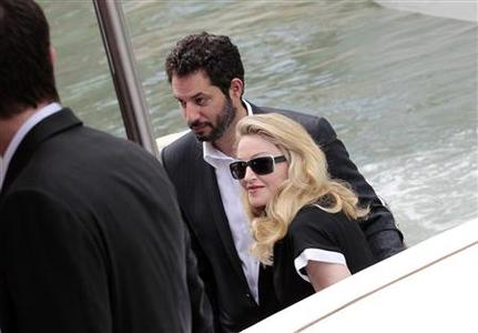 U.S. pop star Madonna (R), director of movie ''W.E'', arrives at the Film Cinema's Place in Venice during the 68th Venice Film Festival September 1, 2011. REUTERS/Alessandro Bianchi