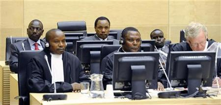 Three Kenyan suspects (back row from L to R), William Ruto (L), Henry Kosgey (C) and Joshua Arap Sang (R), accused of crimes against humanity in their country's post-election violence in 2007-08, make their initial appearance at the International Criminal Court (ICC) in The Hague April 7, 2011. REUTERS/Pool