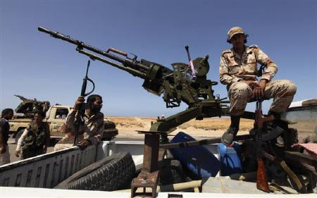 A Libyan rebel mans a vehicle-mounted weapon as they gather in the Al-Noflea area, near Gaddafi's hometown of Sirte, August 29, 2011. The huge numbers of weapons circulating in a postwar Libya with unsecured borders pose a risk to Europe and other nations, the European Union's senior representative in Tripoli said on Friday. REUTERS/Esam Al-Fetori