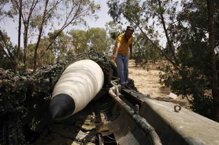 An anti-Gaddafi fighter shows a Russian made Scud missile launcher that was found in Junine, about 25 km southeast of Tripoli, September 3, 2011. The loaded missile launcher was aimed at the city of Tripoli. REUTERS/Youssef Boudlal