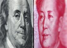 Банкноты в 100 долларов и 100 юаней в Тайбэе, 20 июня 2010 года. Курс юаня снизился к доллару в понедельник из-за укрепления американской валюты на фоне растущего беспокойства о долговых проблемах еврозоны и экономических перспективах США. REUTERS/Nicky Loh