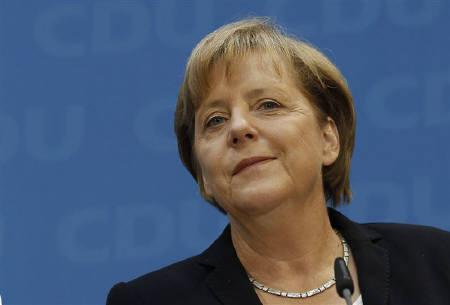 German Chancellor and leader of the Christian Democratic Union (CDU) Angela Merkel attends a news conference after yesterday's  Mecklenburg-Vorpommern state election at the CDU headquarters in Berlin, September 5, 2011.  REUTERS/Thomas Peter