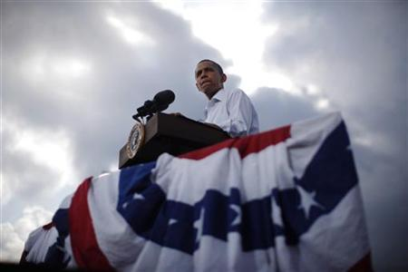 President Barack Obama is pictured as the sun breaks through clouds at a town hall-style event in Alpha, Illinois, August 17, 2011. REUTERS/Jason Reed