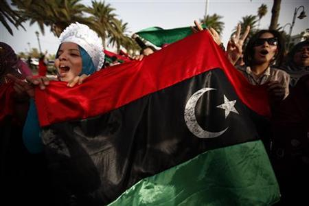 Women chant anti-Muammar Gaddafi slogans during a demonstration at Martyrs Square in Tripoli September 2, 2011. REUTERS/Zohra Bensemra