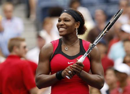 Serena Williams of the U.S. smiles after defeating Ana Ivanovic of Serbia in their match at the U.S. Open tennis tournament in New York, September 5, 2011.  REUTERS/Eduardo Munoz