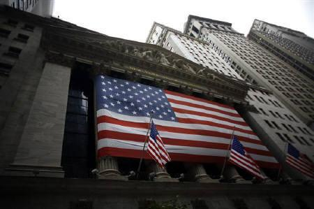 A flag hangs outside the New York Stock Exchange September 22, 2008. REUTERS/Eric Thayer/Files