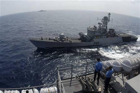 Indian naval ships take part in an exercise in the Bay of Bengal off Chennai in this January 24, 2010 file photo. REUTERS/Babu/Files