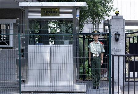A paramilitary policeman stands guard at the entrance of the Libyan embassy in Beijing, September 6, 2011. REUTERS/Jason Lee