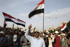 Anti-government protesters shout slogans as they march during a demonstration to demand the ouster of Yemen's President Ali Abdullah Saleh in Sanaa September 6, 2011. REUTERS/Khaled Abdullah