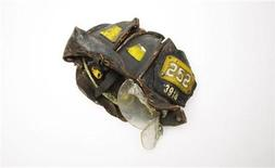 <p>A recovered FDNY Squad 252 helmet belonging to deceased FDNY member Kevin M. Prior is seen in this photograph before becoming a part of the National September 11 Memorial & Museum in New York August 22, 2011. Kevin Prior, a firefighter with Brooklyn's Squad 252, can be seen in video footage of the North Tower lobby recorded after the first plane hit getting ready to go upstairs. Responding to a mayday call sent out by fellow firefighters encountering breathing problems, he and five other members of the squad are thought to have been on a floor in the 20s when the tower collapsed. Prior's body was found three weeks after the attacks and buried on Long Island, but his mother was troubled that his helmet had not been returned to the family, and said as much in a television interview. An employee at the city's Office of the Chief Medical Examiner happened to catch the broadcast, recognized Prior's squad and badge numbers, and hand-delivered the badly damaged helmet to his grateful family. The museum, which occupies seven stories below the ground of the World Trade Center site--is still being built at the site of the fallen towers. It is due only to open in 2012, on the 11th anniversary of the attacks. REUTERS/Lucas Jackson</p>