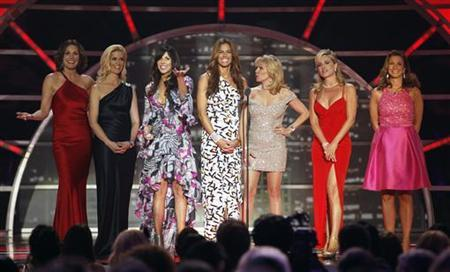 The cast of ''The Real Housewives of New York City'' present an award during the 2011 TV Land Awards in New York April 10, 2011. REUTERS/Lucas Jackson